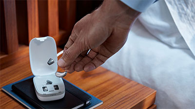Signia Pure Charge&Go X hearing aid in a charger